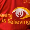 Shirt Logo Switch, Klopp Spot & Auction Lead Liverpool & Standard Chartered's 'Seeing Is Believing' CSR Campaign